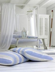 20 striped-floor-pillows-in-a-scandinavian-decorated-bedroom